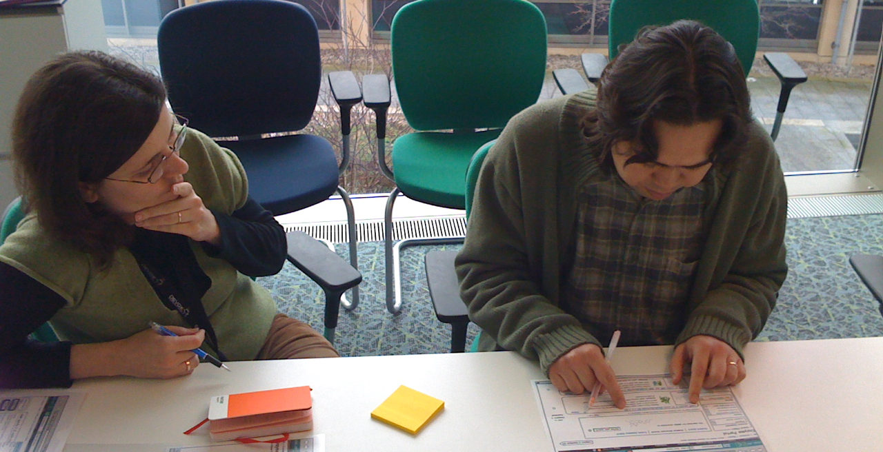 Paula doing paper prototyping testing